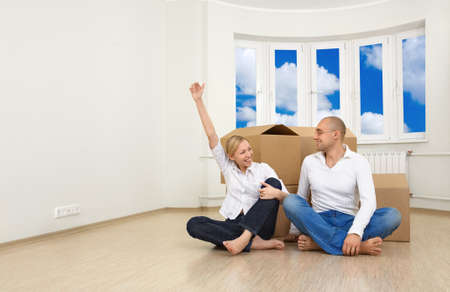 A man and a woman are happy with their new flat photo