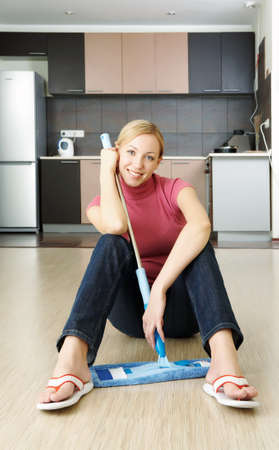 finished: A woman has just  finished cleaning up a flat