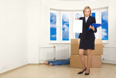 A business woman produces a warrant a debtor in a room photo