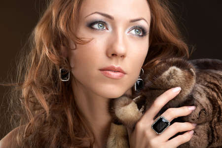 The beautiful woman in furs and jewelry photo