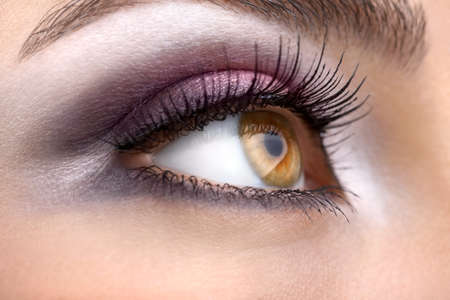 A womans right hazel eye looking ahead