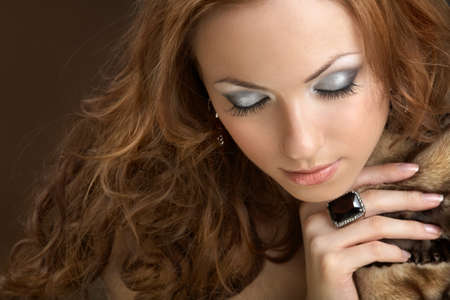 Attractive well dressed woman with closed eyes photo