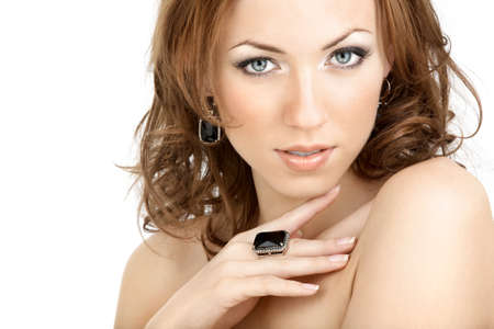 bared: The beautiful woman in jewelry with the bared shoulders Stock Photo