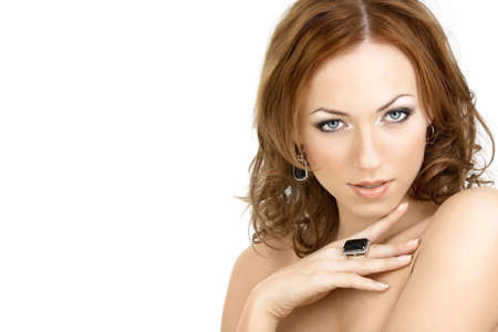 The seductive woman with the bared shoulders in the jewelry, isolated   photo