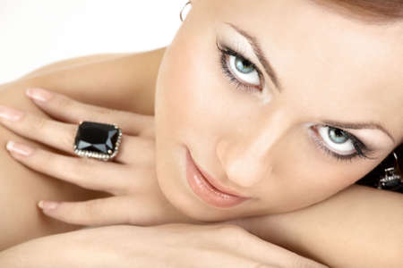 Close up a portrait of the beautiful woman with the jewelry, isolated   photo
