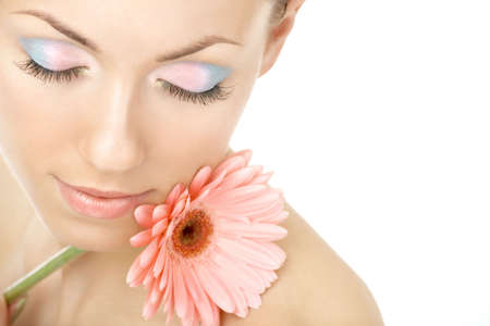 Portrait of the young woman blindly and pink gerbera