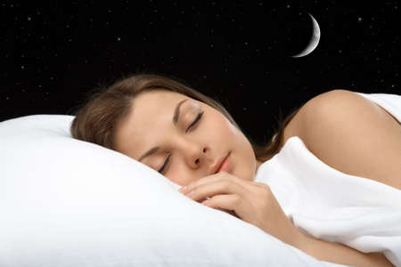 lying on side: Portrait of the sleeping woman against the star sky, horizontally Stock Photo