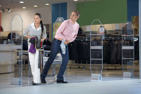 The pair steals clothes from shop and escapes Stock Photo