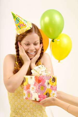 accepts: Pleasantly surprised birthday woman accepts a gift