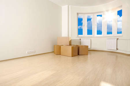 shined: Interior of an empty room with the boxes, shined with a sunlight