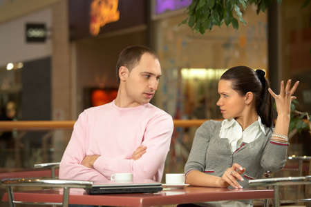 misunderstanding: Scene in cafe - misunderstanding between the enamoured girl and the guy Stock Photo