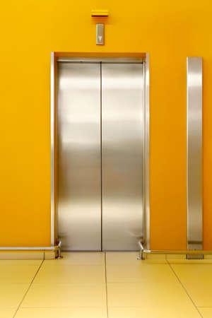 Photo of shining doors of the lift and orange walls around Stock Photo - 4828034