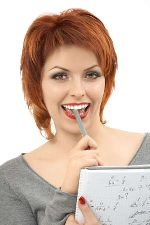 The friendly girl laughs, solving the mathematical problem, isolated photo