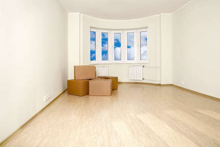 shined: Interior of an empty room with the packed boxes, shined with a sunlight