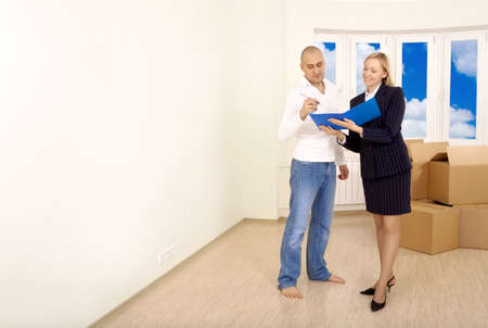 Signing of documents by the owner in an interior of new apartment photo