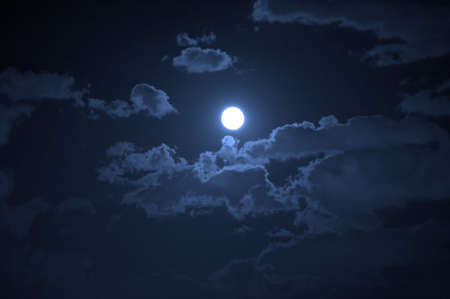 Night landscape of the cloudy sky and the moon Stock Photo