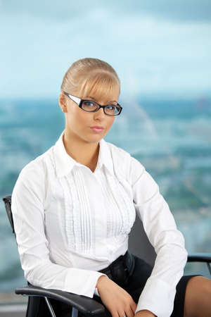 The image of the stylish business woman at office photo
