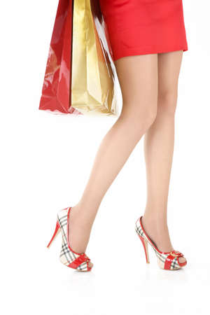 Legs of the woman with the packages, isolated on a white background photo