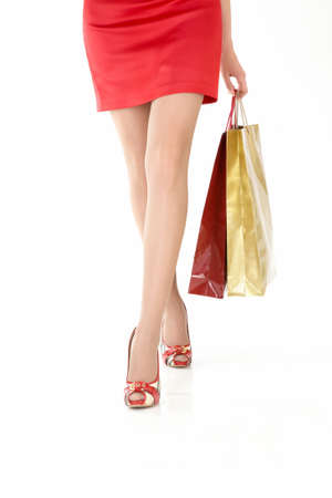 The front view of going female legs with the gift packages, isolated photo