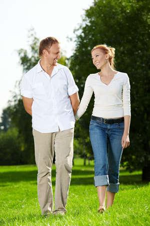 walk in: Walk of a cheerful couple in a summer garden