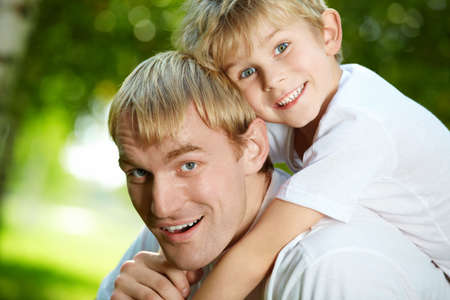Daddy carries on a back of small son Stock Photo - 5593932