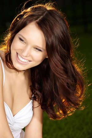 Portrait of beautiful laughing girl with long curly healthy hair Stock Photo