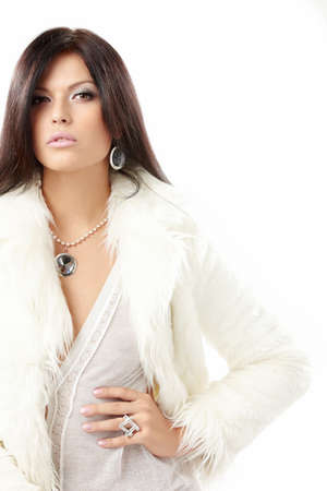 Beautiful woman in a white fur coat with the jewelry, isolated photo