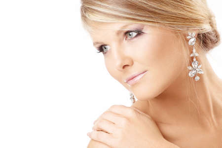 Portrait of the beautiful blonde with jewelry, isolated photo