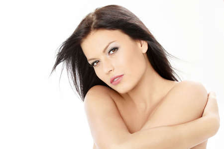 bared: Beautiful woman clasps the bared shoulders, isolated