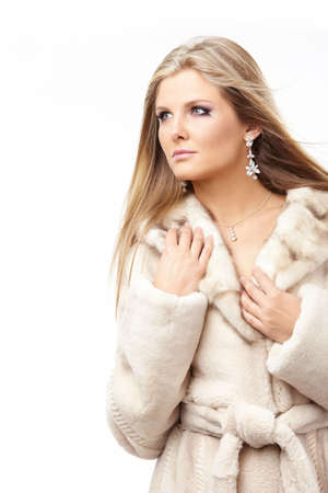 Beautiful blonde in the light fur coat, isolated Stock Photo - 5815997