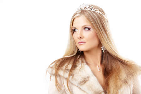Portrait of charming blonde with a diadem on a head and the fur collar, isolated   Stock Photo - 5901843