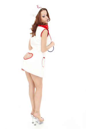 Woman in a sexual suit of the nurse, isolated photo