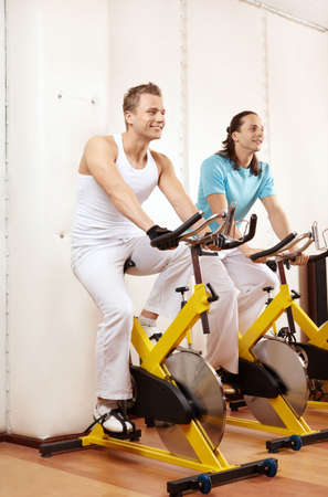 Two men on bike to fitness club photo