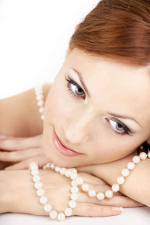 bared: The dreaming woman with a pearl necklace on the bared shoulders