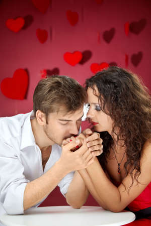 Enamoured man kisses hands of the beautiful woman  photo
