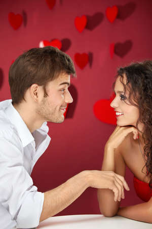 Conversation of two flirting enamoured on a red background photo