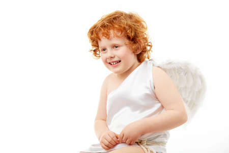 Cheerful little boy in an image of the cupid, isolated on a white background photo