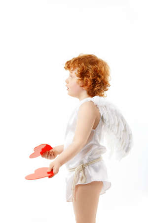 Profile of the small cupid with hearts in the hands, isolated on a white background photo