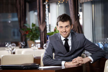 Portrait of the smiling business man at restaurant photo