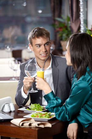 Happy young couple has dinner at restaurant photo