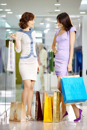 Two beautiful young girls consider the purchases photo
