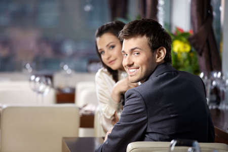 to expect: Smiling couple expect the order at restaurant