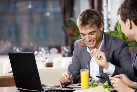 lunch meeting: Two business men have dinner at restaurant Stock Photo
