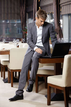 urban planning: The business man at restaurant with the laptop Stock Photo