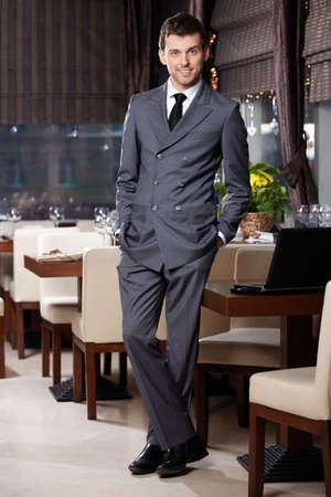 manager: Attractive business man in suit stay in restaurant
