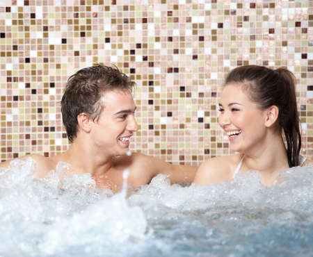 Young happy people relax in a pool Stock Photo - 6439755