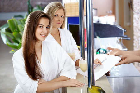 Two attractive girls at a bar rack Stock Photo - 6439756