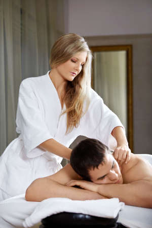 The girl does massage to the client photo