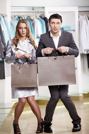 The surprised guy and the girl with packages in hands in shop Stock Photo - 6439783