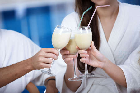 People meet glasses cocktails on a forward background photo